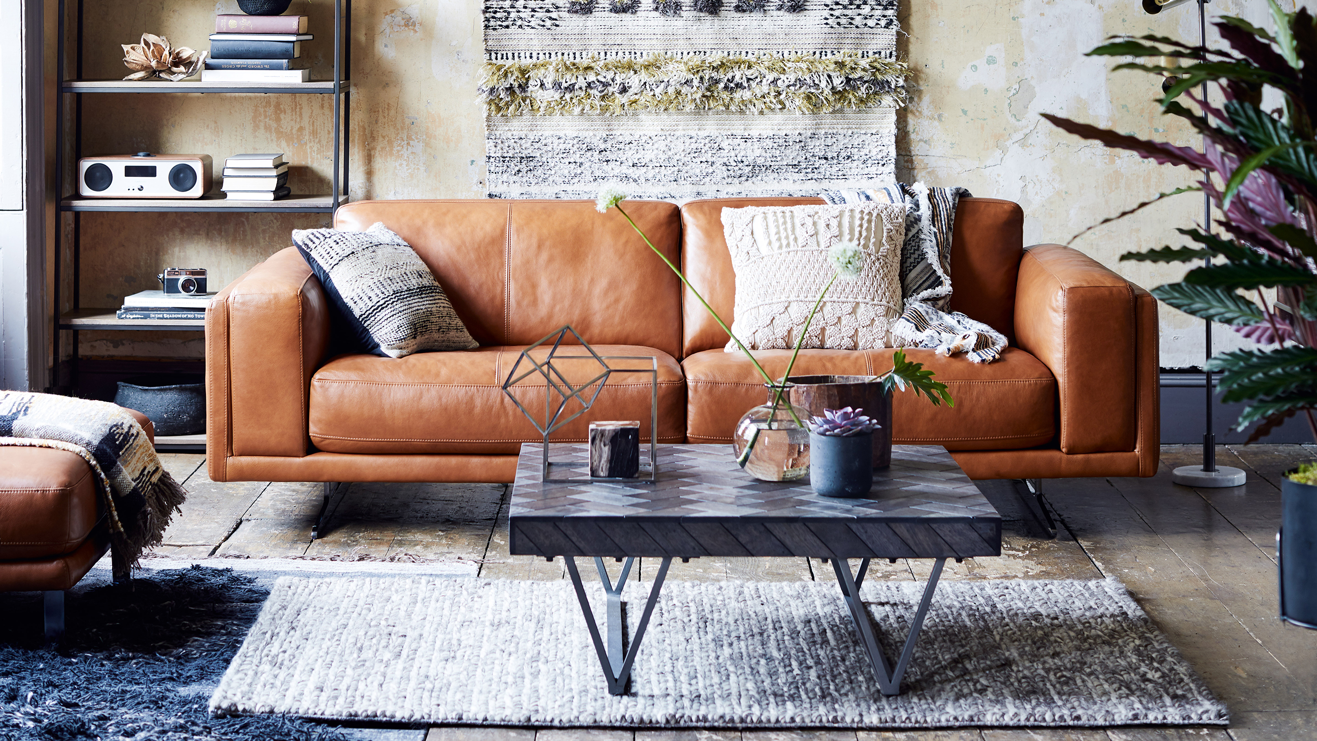 leather sofas dfs dog sofa beds uk the latest designed by and french connection home this 1970s style tan couch stands on metal legs