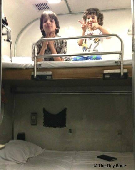 Kids getting ready to sleep... sleep? Sleeping on a train, Bangkok, traveling the world with kids