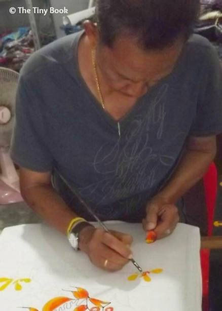 Koh Samui: This man painted colorful fantasy on silk, cotton and other natural fabrics.