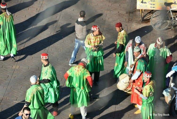 Moroccan traditional dancers. Get your coins ready. Avoid scams in Marrakech