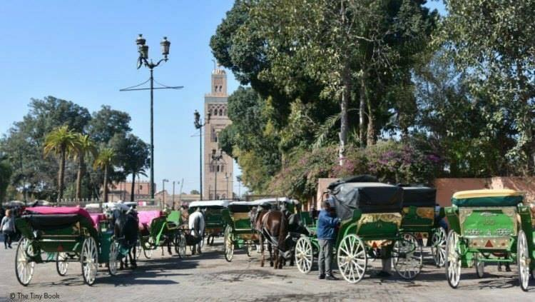 Side street leading to the Main Mosque, horse carts. Avoid scams in Marrakech
