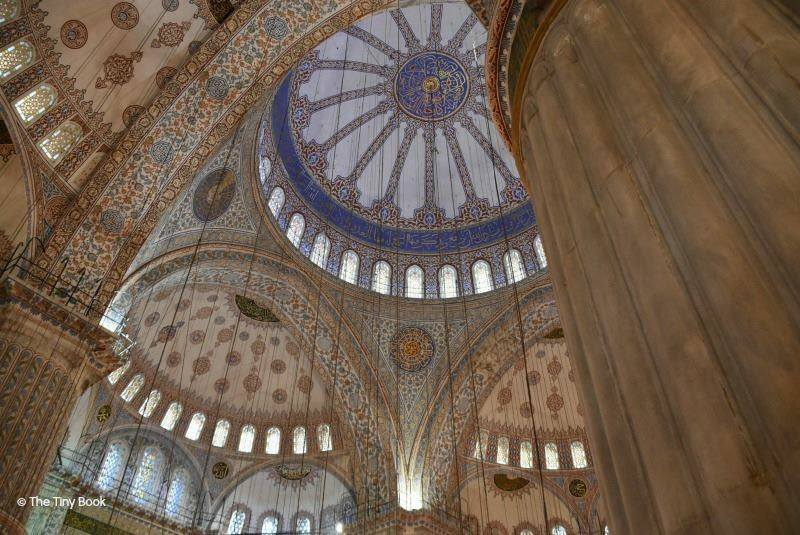 The Holy Soul of Istanbul: Impressive ceilings, massive columns, light and silence mix together inside the Blue Mosque,
