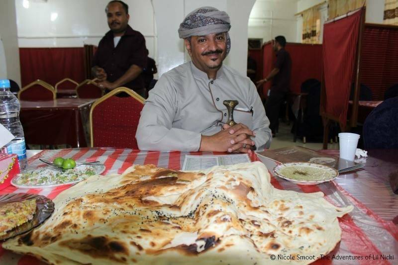 Jameel (her guide in Sana'a) having a Yemeni lunch.