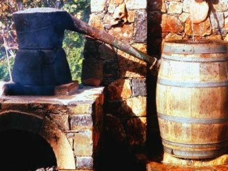 Cauldron used to distill Raki.Greek tastes: Raki, a glass of cretan culture