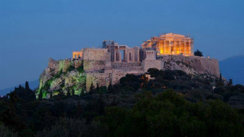 Acropolis rock standing proud during dusk. Summer Activities in Athens. Why not?