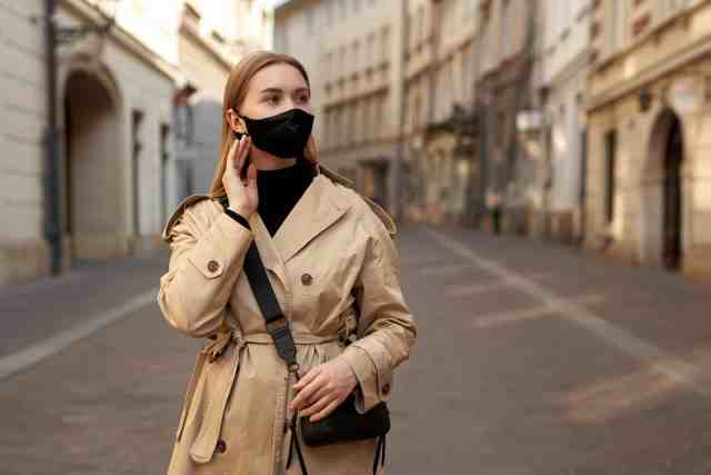 A woman traveler with a face mask. Masks are useful travel accessories, best accessories for travel