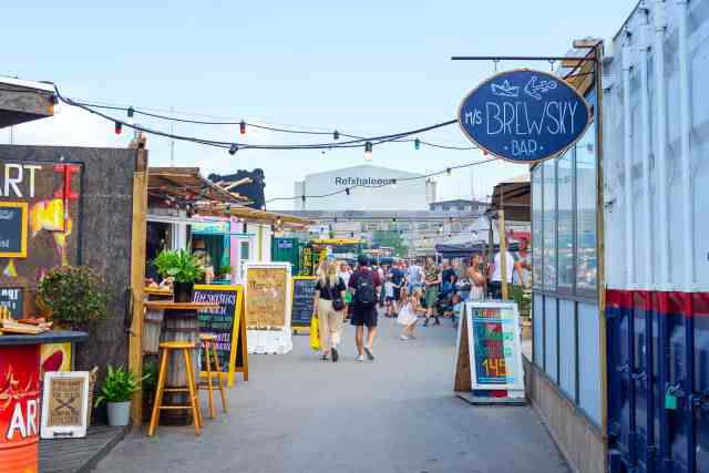 Various beautiful street food cafes at Reffen street food market. one of copenhagen best places for a cool day and great food. copenhagen attractions are the best!