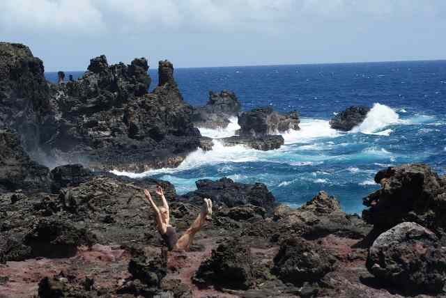 Hawaiian view and a woman in yoga pose