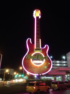 Nighttime view of the famous Hard Rock guitar