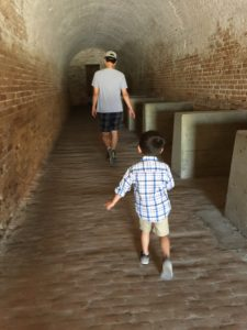 Tyler and Dad exploring tunnels at Fort Pickens