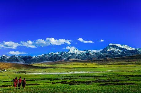 Tibetan Monks on the Grasslands of the Tibetan Plateau