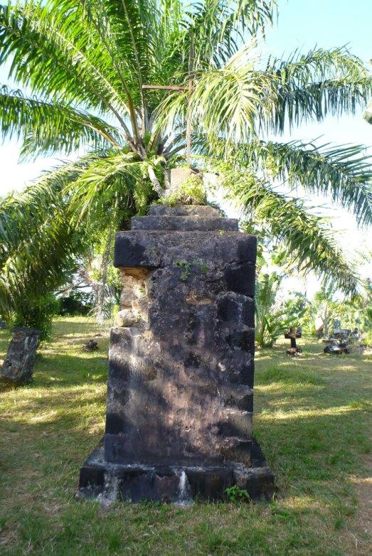 A standing headstone in the Pirate cemetery. Photo Credit: deruneinholbare/
