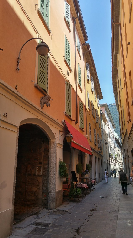 Restaurant, narrow street, alley, Como, City of Como, Province of Como, Lombardy, Italy