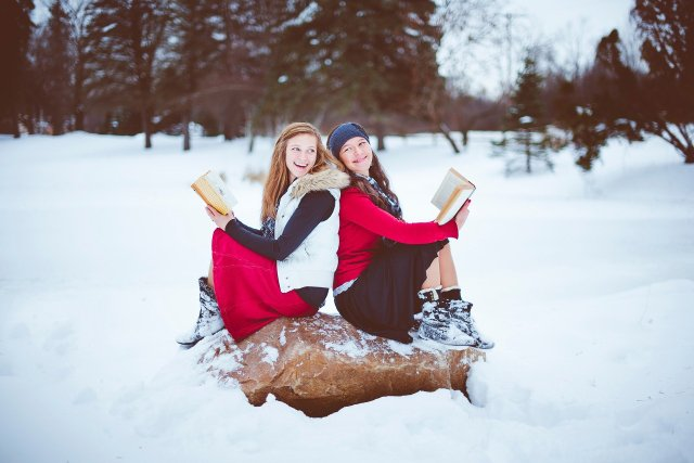 Girls reading in the snow