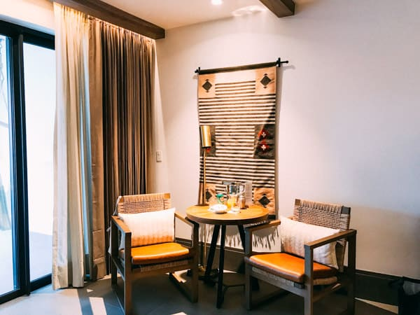 table and chairs with tapestry on wall riviera maya mexico unico 2087