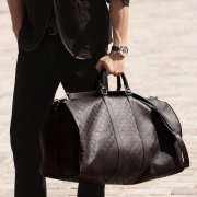 Travel in style: Damier Infini Keepall 55 Bandouliere by Louis Vuitton