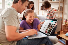 Family Using Inspiron 15 Touch Notebook At Home