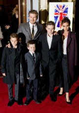"David Beckham and Victoria Beckham pose on the red carpet with three of their children, (L-R) Romeo, Cruz and Brooklyn as they arrive for the premiere of the Spice Girls musical ""Viva Forever"" in central London on December 11, 2012. Viva Forever is produced by Judy Craymer, written by Jennifer Saunders and features the music of the Spice Girls. AFP PHOTO/Leon Neal (Photo credit should read LEON NEAL/AFP/Getty Images)"