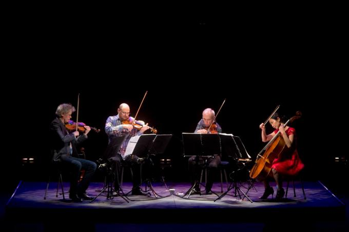 (From left) David Harrington, John Sherba, Hank Dutt and Sunny Yang of the Kronos Quartet perform at the Irvine Barclay Theatre Saturday night. ///ADDITIONAL INFO: lbr.cavalierclassic.0113.dak 02/21/15 - Photo by DREW A. KELLEY, CONTRIBUTING PHOTOGRAPHER