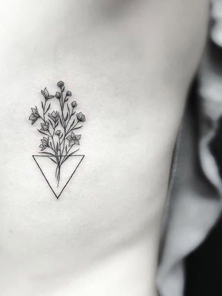 Small Flower Rib Tattoo