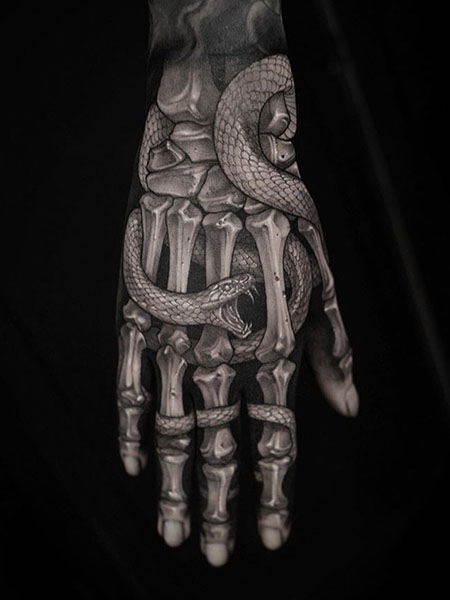 Realistic Skeleton Hand With Snake Tattoo