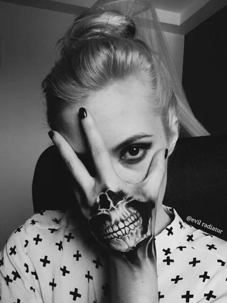 Skeleton Mouth Hand Tattoo