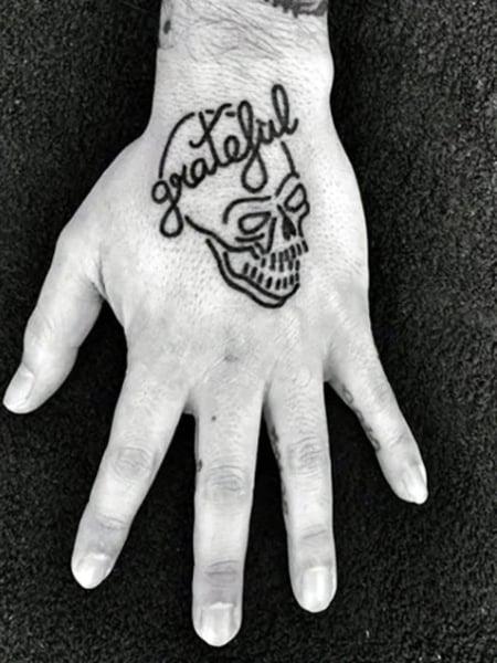 Minimalist Skeleton Hand Tattoo