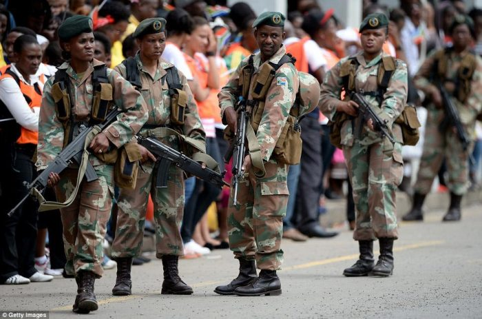 High security: Soldiers in full combat gear, male and female, were stationed on foot on either side of the road from the airport in Mthatha