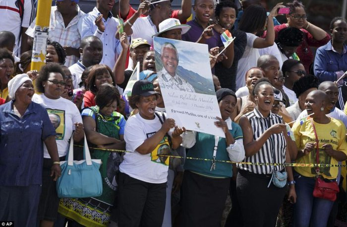 Crowds of mourners cheer as they await the motorcade: Mandela languished in jail for 27 years for his opposition to the racist apartheid regime. Freed in 1990, he emerged to forge a new democratic South Africa by promoting forgiveness and reconciliation