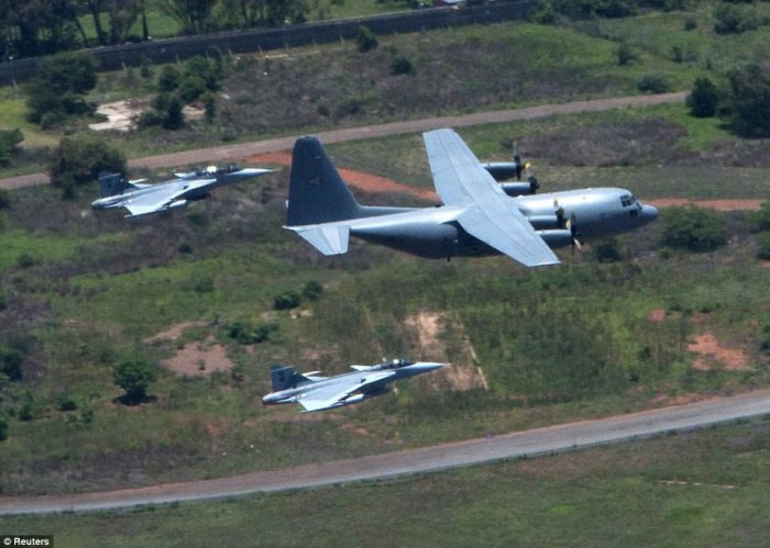 Full military honours: Fighter jets escort the military plane carrying the coffin of former South African President Nelson Mandela as it is flown to Mandela's home in the village of Qunu, Eastern Cape