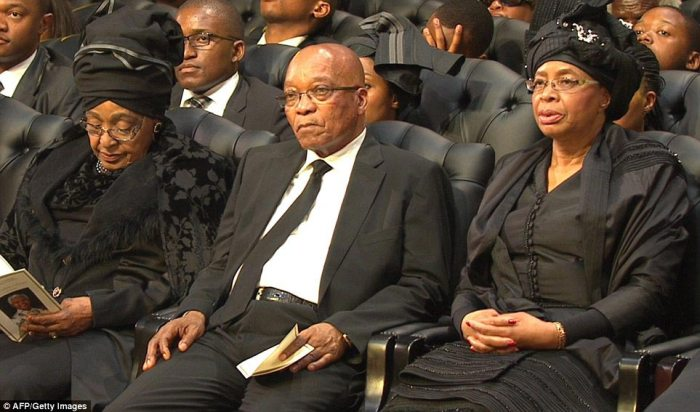 Sombre: South Africa's current president Jacob Zuma sitting between Winnie Mandela and Graca Machel
