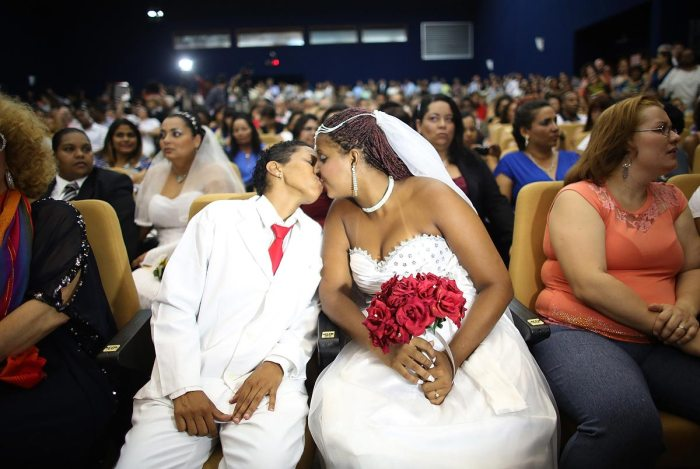 Joyce and Gabrieli (R) kiss before marrying at what was billed as the world's largest communal gay wedding on December 8, 2013 in Rio de Janeiro, Brazil. 130 couples were married at the event which was held at the Court of Justice in downtown Rio. In May, Brazil became the third country in Latin America to effectively approve same-sex marriage via a court ruling, but a final law has yet to be passed. (Photo by Mario Tama/Getty Images)