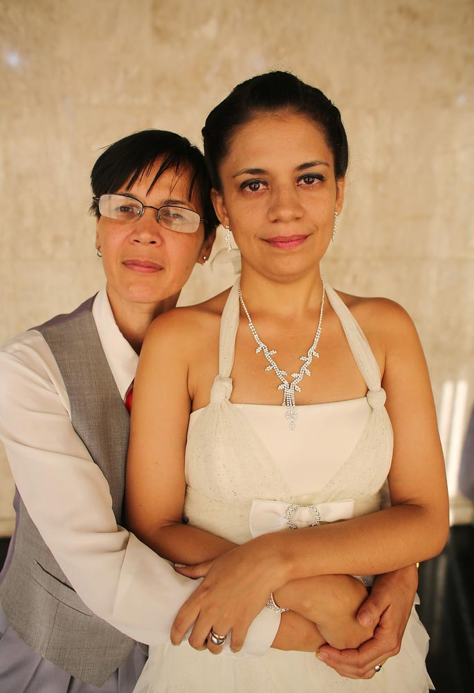 Couple Claudia and Giselle (R), together 7 years, pose after marrying at what was billed as the world's largest communal gay wedding on December 8, 2013 in Rio de Janeiro, Brazil. 130 couples were married at the event which was held at the Court of Justice in downtown Rio. In May, Brazil became the third country in Latin America to effectively approve same-sex marriage via a court ruling, but a final law has yet to be passed. (Photo by Mario Tama/Getty Images)