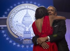 President Barack Obama holds first lady Michelle Obama as they dance at an Inaugural Ball, Monday, Jan. 21, 2013, at the Washington Convention Center in Washington, during the 57th Presidential Inauguration. (AP Photo/Carolyn Kaster)
