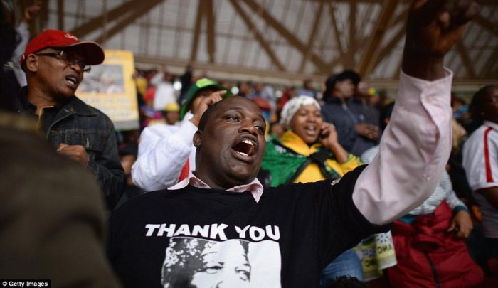 Passion: The huge number of mourners at the ceremony is testimony to the impact Mandela made on his country