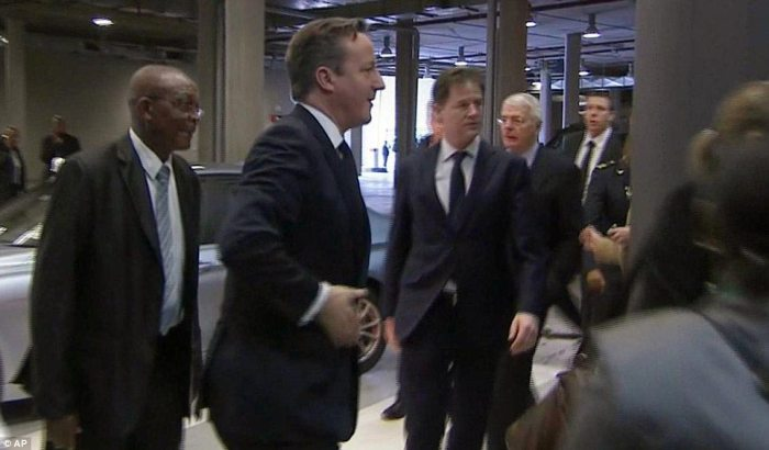 Arrival: Mr Cameron, Mr Clegg and John Major walking in to the FNB Stadium this morning