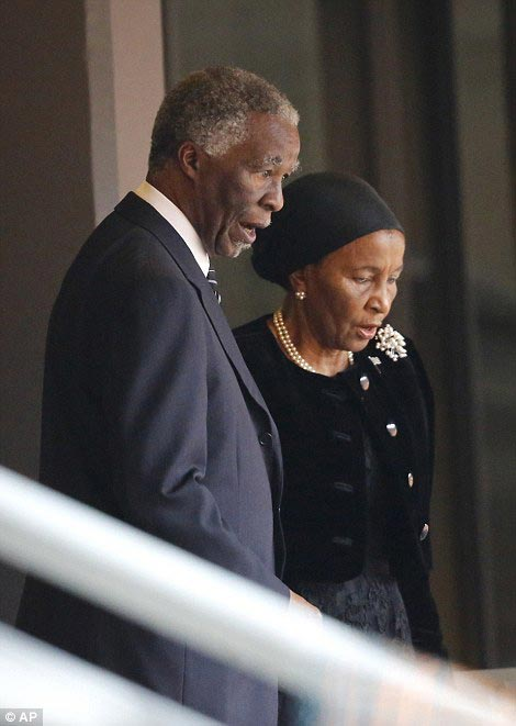 Successor: Former South African President Thabo Mbeki inside the venue with his wife Zanele (right)