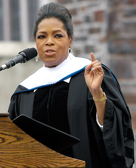 """May 2009 While delivering the commencement address at Duke University, Winfrey shared this life wisdom: """"If you can see the possibility of changing your life, of seeing what you can become and not just what you are, you will be a huge success."""" (Photo Credit: Credit: Sara D. Davis/Getty)"""