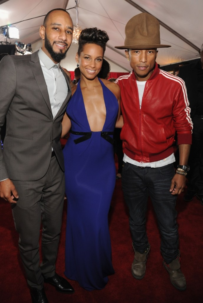 Swizz Beatz, Alicia Keys and Pharrell Williams arrive at the 56th Annual GRAMMY Awards on Jan. 26 in Los Angeles (Photo Credit: Kevin Mazur/WireImage.com)