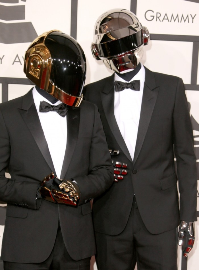 Daft Punk arrive at the 56th Annual GRAMMY Awards on Jan. 26 in Los Angeles (Photo Credit: Jeff Vespa/WireImage.com)