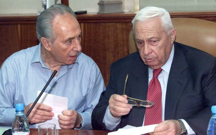 Ariel Sharon talks with his Foreign Minister Shimon Peres during a cabinet meeting in April 2001 in Jerusalem (Picture: EPA)