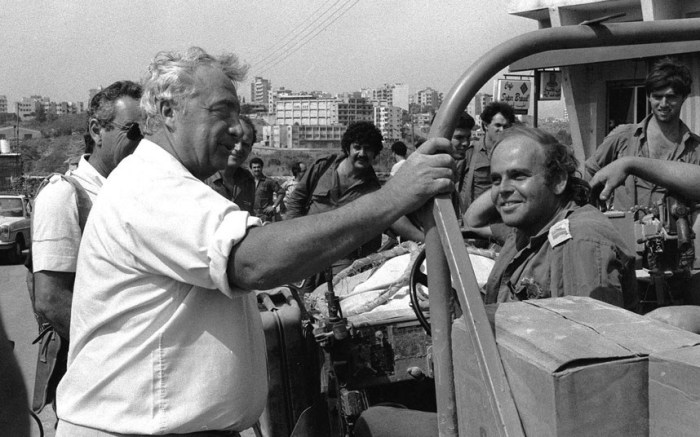 Ariel Sharon, then Israel's defence minister, talks with Israeli troops during a visit to east Beirut, Lebanon, in July 1982. Israel should have killed Yasser Arafat 20 years ago, while he was under Israeli siege in Beirut, Sharon said in an interview. Sharon was defence minister at the time, and led the push to drive Arafat and the Palestine Liberation Organization out of Lebanon. (Picture: AP)