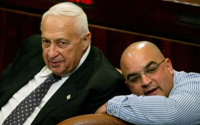 Ariel Sharon with his son Omeri in the Israeli parliament in Jerusalem (Picture: Reuters)