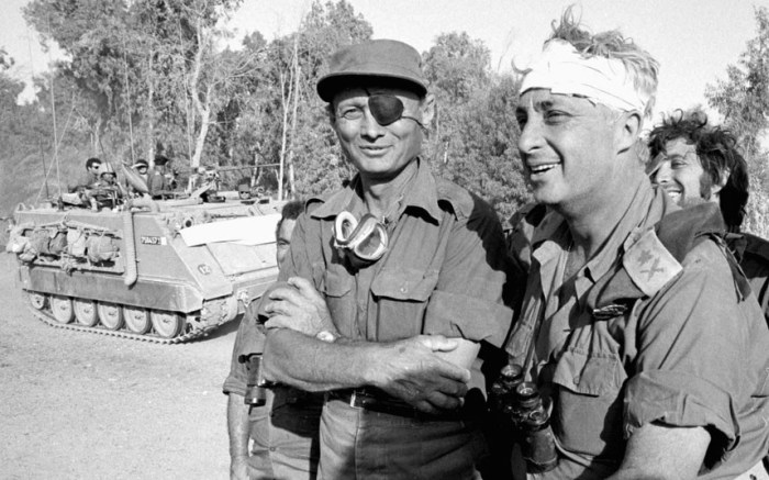 Ariel Sharon (R), recovering from a head injury, with Moshe Dayan on the western side of the Suez Canal in October 1973 (Picture: REUTERS/Israeli Defense Ministry)