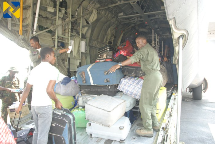 NAF personnel arranging personal effects of the evacuees (Photo Credit: Defence Information)