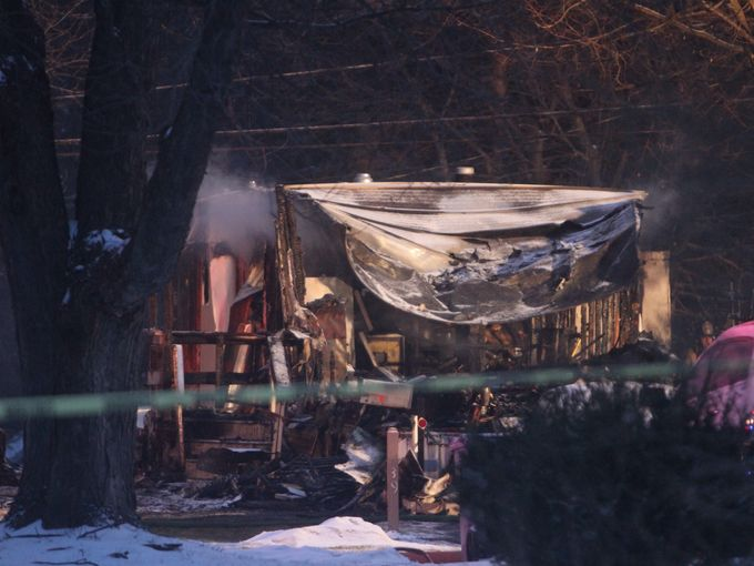 Three died including a child in a fire at a mobile home on Fondiller Avenue in Penfield. (Photo Credit: JAMIE GERMANO/Democrat & Chronicle)