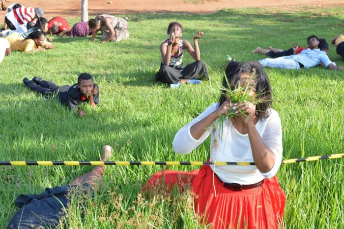 SHOCKING: Members feasting on grass (Photo Credit: Facebook)