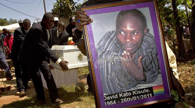 """In 2011, prominent Ugandan gay rights campaigner David Kato was bludgeoned to death at his home after a different newspaper splashed photos, names and addresses of gays in Uganda on its front page along with a yellow banner reading """"Hang Them"""" (Photo Credit: AFP)"""