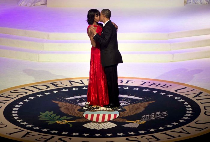 US President Barack Obama and First Lady Michelle Obama kiss while dancing at the Commander and Chief Ball at the Washington Convention Center January 21, 2013 in Washington, DC. Obama and Biden attended Inauguration balls after being ceremonially sworn in for a second term leading the United States earlier today. (Photo Credit: AFP PHOTO/Brendan SMIALOWSKIBRENDAN SMIALOWSKI/AFP/Getty Images)