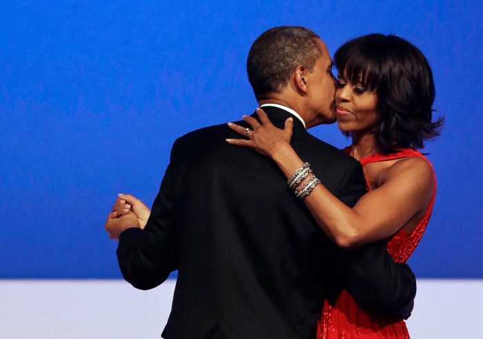 This Jan. 21, 2013 file photo shows President Barack Obama kissing first lady Michelle Obama during their dance at the Commander-in-Chief Inaugural Ball at the Washington Convention Center in Washington. Nobody would call bangs a new trend, but when the first lady's involved, things take on more significance. In fact, President Barack Obama did call his wife Michelle's new hairdo the most significant event of his second inauguration. (Photo Credit: AP Photo/Jacquelyn Martin, File)